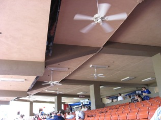 Overhead fans help spread mist at the LV baseball stadium
