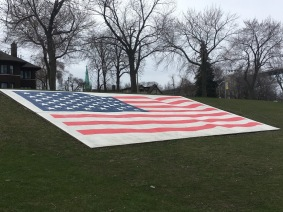 The large concrete US flag to the memorial's right