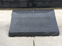 The Purple Heart at the memorial's base